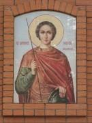Икона Св. вмч. Георгия Победоносца на фасаде Георгиевской часовни в Мемориальном парке Смоленска.