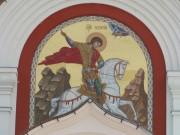 Храмовая икона над входом в Георгиевскую церковь в Романово Медынского района Калужской области.