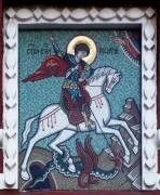 Георгий Победоносец (покровитель Москвы) - мозаичная икона на Воскресенских воротах Китай-города в Москве.