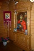 Киот с иконой Георгия Победоносца в интерьере часовни Михаила Архангела в Дунино Одинцовского района Московской области.