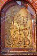Храмовая икона на фасаде часовни Георгия Победоносца в Тарбееве, в городе Долгопрудный Московской области.
