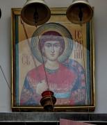 Храмовая икона над входом церкви-часовни Георгия Победоносца на Ивантеевской улице в Москве.