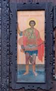Киот с иконой Георгия Победоносца на западном фасаде церкви Николая Чудотворца в Бирюлёво, в Москве.