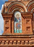 Образ Георгия Победоносца на южном фасаде колокольни церкви Воздвижения Честного Креста Господня в Дарне Истринского района Московской области.