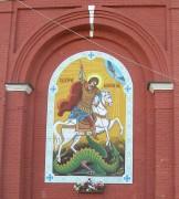 Георгиевская церковь в Болхове Орловской области. Образ Георгия Победоносца на нижнем ярусе колокольни.
