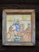 Икона на западном фасаде часовни Георгия Победоносца на западном кладбище в Западной Двине Тверской области.