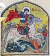 Мозаичный образ Георгия Победоносца на фасаде Казанского собора на Красной площади в Москве.