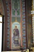 Икона Георгия Победоносца на колонне слева от иконостаса в Троицком соборе в Краснодаре.